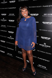 Star Jones sported a sheer long-sleeved cocktail dress for her evening look while at the 'Olympus Has Fallen' screening.