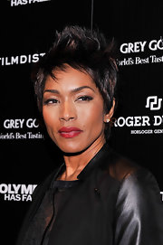 Angela Bassett opted for bright red lips for her beauty look at the 'Olympus Has Fallen' screening in New York.
