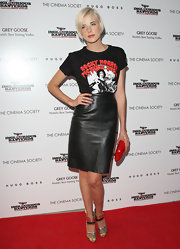 Agyness paired her leather skirt with a graphic print t-shirt.