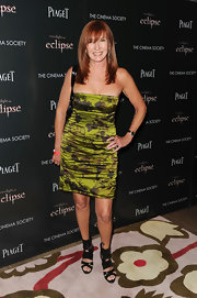 Nicole Miller paired her cut out booties with a green satin strapless dress.