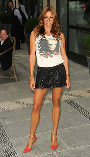 Kelly Bensimon paired her graphic t-shirt with a sequin mini skirt.