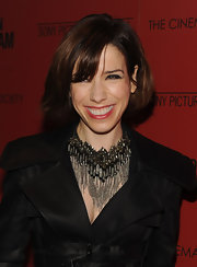 Sally Hawkins paired her classic trench coat with a silver and bronze statement neckalce, complete with long tassels.