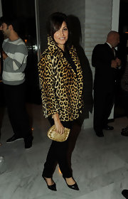 Gina Gershon complemented her leopard-print fur coat with a beaded gold clutch for a luxe look during the screening of 'Good Hair.'