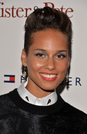 Alicia Keys was rocker-chic with her fauxhawk at the screening of 'The Inevitable Defeat of Mister and Pete.'