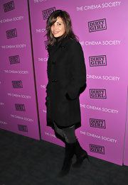 Gina Gershon added a feminine touch to her ensemble with a pair of high-heeled black mid-calf boots at the screening of 'Dirty Girl.'