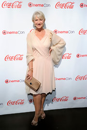Helen Mirren gave her blush dress the perfect complement with a gold quilted Ouloulette Pochette.