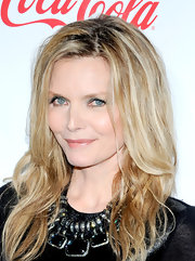 Michelle Pfeiffer wore her hair in tousled layers with a hint of wave at the 2012 CinemaCon awards ceremony.