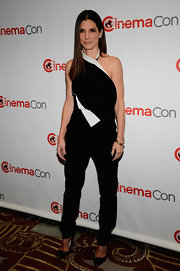 Sandra Bullock chose an asymmetrical halter top for her black-and-white look at CinemaCon.