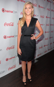 Nicola Peltz paired her dress with classic black Jimmy Choo peep-toes.