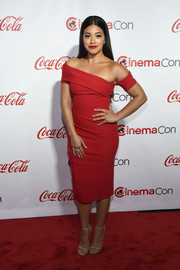 Gina Rodriguez showed off her red-hot style in this asymmetrical off-the-shoulder dress by Haney at the CinemaCon Big Screen Achievement Awards.