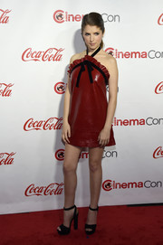 Anna Kendrick cut a flirty figure in a red Philosophy di Lorenzo Serafini leather dress with a ruffled neckline and black halter straps during the CinemaCon Big Screen Achievement Awards.