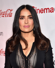 Salma Hayek wore her hair in a center-parted style with curly ends at the CinemaCon Big Screen Achievement Awards.