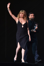 Goldie Hawn flashed plenty of skin in a little black cutout dress at the CinemaCon Big Screen Achievement Awards.