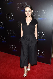 Mila Kunis styled her outfit with chic monochrome ankle-strap sandals by Santoni.