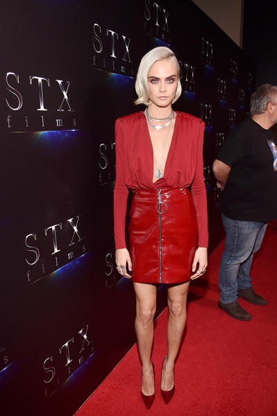 Cara Delevingne polished off her look with red velvet pumps by Jimmy Choo.