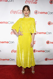Dakota Johnson brightened up the red carpet with this lemon-yellow velvet dress by Attico at the 2018 CinemaCon Big Screen Achievement Awards.