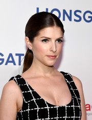 Anna Kendrick went for a sleek center-parted ponytail when she attended CinemaCon 2018.