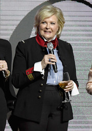 Candice Bergen attended CinemaCon 2018 wearing a black military jacket with red and gold trim.