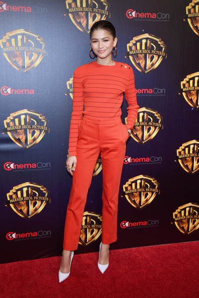 Zendaya Coleman was casual and cute in a striped red sweater by Boss at CinemaCon 2018.