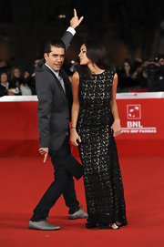 Sarah Kazemy got playful on the red carpet in a black classic column dress made of thick lace.