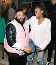 Kelly Rowland was casual in a white V-neck sweater and ripped blue jeans during DJ Khaled's birthday celebration.