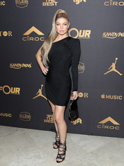 Fergie went for an edgy black one-sleeve dress by Mugler when she attended DJ Khaled's birthday celebration.