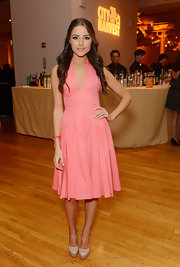 Olivia Culpo's nude platform pumps balanced out her bright pink dress.