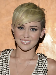 Miley Cyrus showed off her blonde locks with this edgy 'do that featured shaved sides and textured bangs.