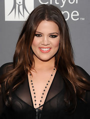 Khloe Kardashian added a shiny touch to her glowing look with coral gloss.