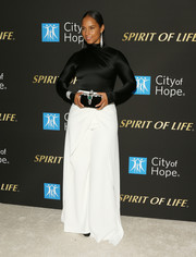 Alicia Keys teamed her top with white wide-leg pants, also by Brandon Maxwell.