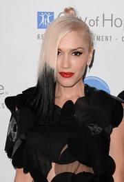 Gwen Stefani may have deviated from her platinum-blonde look, but the signature red lip stayed.