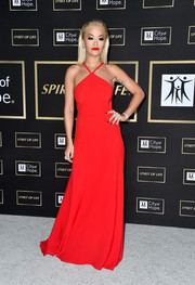 Rita Ora looked radiant in a red halter gown by Prada at the City of Hope Gala.