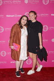 Beanie Feldstein went for casual styling with a pair of black leather sneakers.
