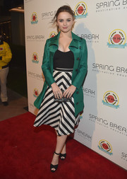 Joey King arrived for the City Year Los Angeles Spring Break looking super chic in an emerald-green trenchcoat.