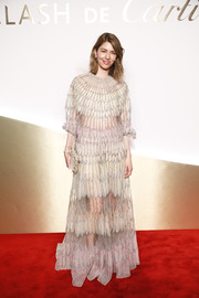 Sofia Coppola made an enchanting choice with this partially sheer feather-motif gown for the Clash de Cartier launch.