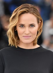 Judith Godreche wore her hair in a short wavy style at the Cannes Film Festival photocall for 'The Climb.'