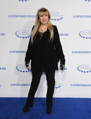 Stevie Nicks layered a menswear-inspired black blazer over a billowy blouse for a totally elegant look.
