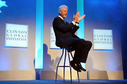 Bill Clinton wore an expensive looking pair of brown leather loafers with his suit.