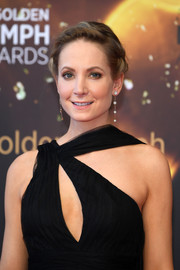 Joanne Froggatt wore her hair in a simple braided updo at the 2018 Monte Carlo TV Festival closing ceremony.