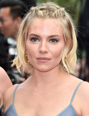 Sienna Miller sported a boho-chic braided half-up 'do at the Cannes closing ceremony.