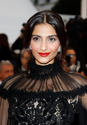 Sonam Kapoor completed her ultra-glam look with a center-parted half-up half-down 'do at the Cannes Film Festival closing ceremony.