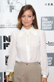 Olivia Wilde showed her more conservative side with this long-sleeve white Michael Kors blouse during the gala presentation of 'Her.'