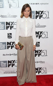 Olivia Wilde took a fashion risk with a pair of beige wide-leg pants and a long-sleeve white blouse when she attended the gala presentation of 'Her.'