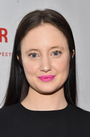 That bright pink lipstick took a lot of the edge off Andrea Riseborough's goth look.