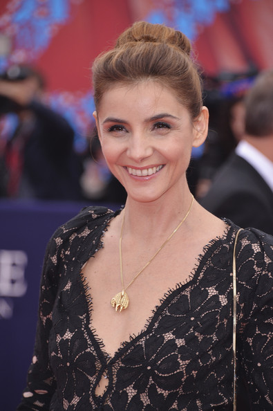 Clotilde Courau Loose Bun [hair,face,hairstyle,eyebrow,premiere,blond,smile,long hair,carpet,dress,deauville,france,deauville american film festival,opeing ceremony,ceremony,clotilde courau]