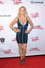 Genevieve Morton looked oh-so-sexy all the way down to her black strappy sandals.