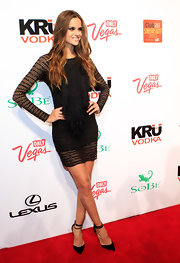 Izabel Goulart wore this sheer black dress to the SI Swimsuit Overtime event.