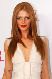 Cintia Dicker looked smoking hot with her lips painted in red at the Sports Illustrated event.