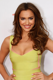 Irina Shayk gave her look a little va-va-voom with long center part curls at the 'SI' swimsuit party.