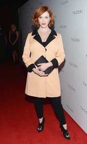 Christina Hendricks was business-chic at the Club Tacori event in a peach Moschino coat with black lapels and cuffs.